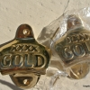 2 of XXXX Gold beer Bottle Opener solid brass works screws heavy polished